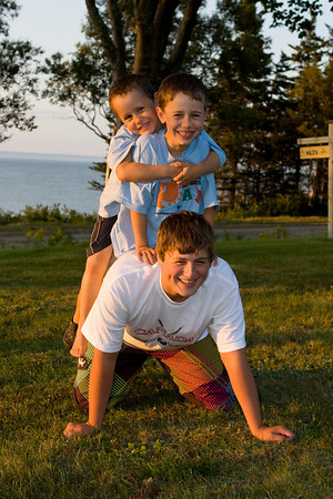 Taylor, Ryan & Patrick trying to pose for group photo, Black Rock cottage